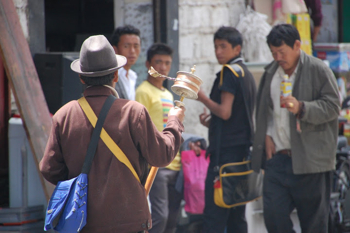 Tibet - Lhasa - Pedestrian with a Prayer Wheel