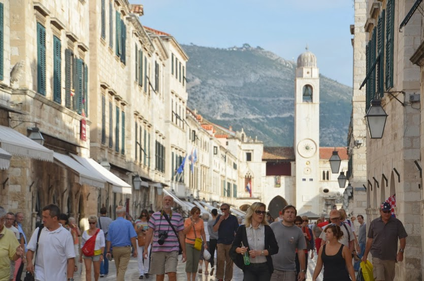 The main street in the old city is rammed with tourists during the day.