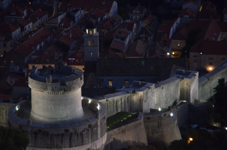 The city walls are lit up at night.