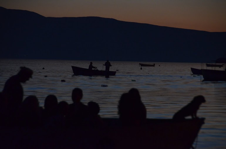 Tourists return to town after a sunset cruise.