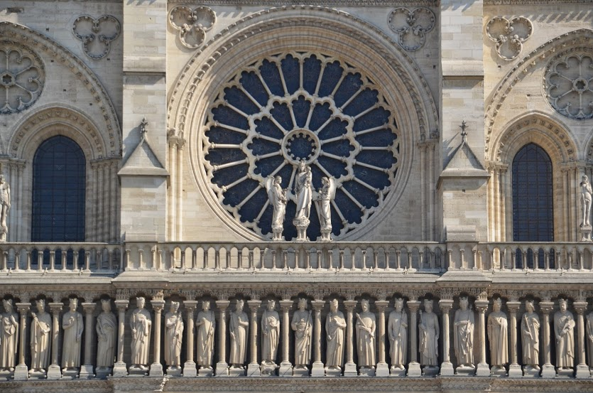 Intricate masonry work adorns the front of the cathedral